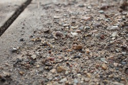 Sediment and rocks on the pavement
