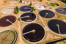 Sedimentation water basins at sewage treatment plant. Sewage treatment plant removes contaminated wastewater and turns it into environmentally safe clean water