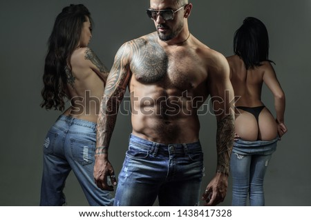 Seduction and masculinity. Seductive heterosexual man showing his muscular body to sexy women, seduction concept. Athletic hispanic man using seduction tactics. Process of seduction.