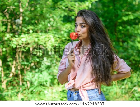 Seductive appetite. Girl holds fork with juicy ripe tomato. Girl seductive eats red vegetable. Lady attractive brunette eats tomato. Woman full of desire eating tomato. Girl adores ripe tomatoes.