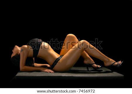 seductive brunette in underclothes isolated on black background