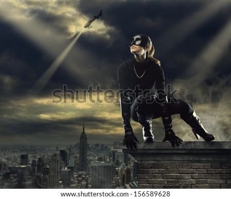 Seductive Female thief running away over the rooftops