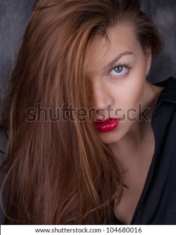 Seductive Portrait of Beautiful Young Long Haired Woman
