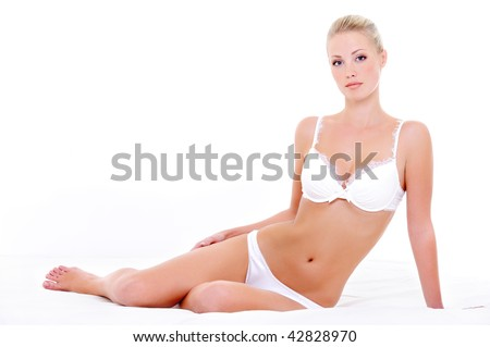 Seductive sexy white lingerie on the beautiful young woman with perfect health body