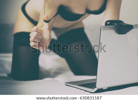 Seductive woman working on as webcam model. Virtual sex.