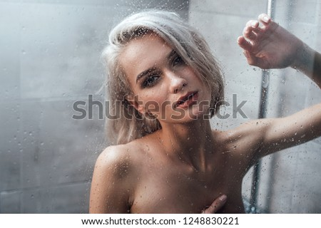 Charming topic nude woman taking shower