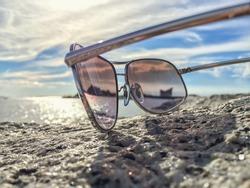 See through sunglasses on the beach