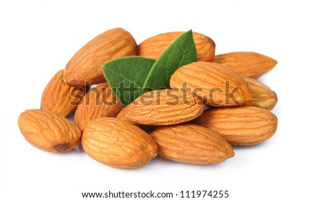 Seed of almonds nuts with leaves on white