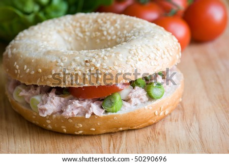 Seeded bagel filled with tuna salad