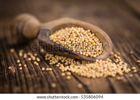 Seeds (Mustard) as high detailed close-up shot on a vintage wooden table (selective focus) #535806094