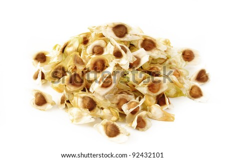 seeds of Moringa on white