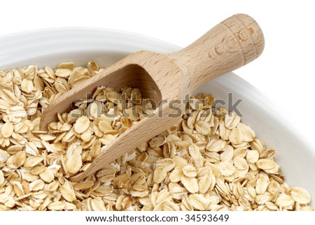 Seeds of oats with wooden spatula. Macro