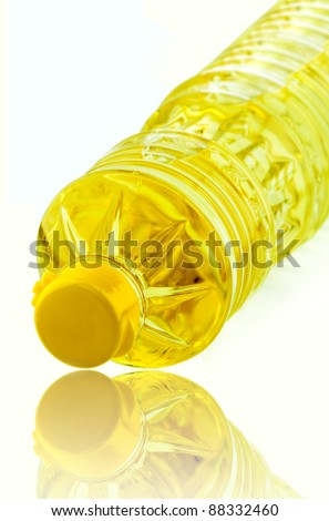 Seeds oil in pet bottle over white background