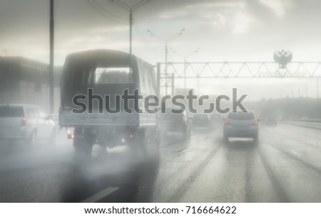 Seeing as there's heavy shower on a highway and road condition looks quite dangerous #716664622