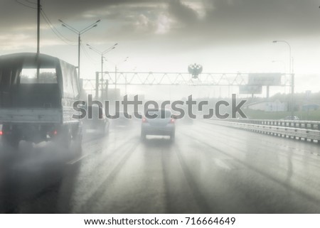 Seeing as there's heavy shower on a highway and road condition looks quite dangerous #716664649
