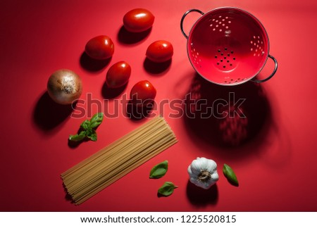 Seeing red - making pasta sauce. A deconstructed scene showing t #1225520815