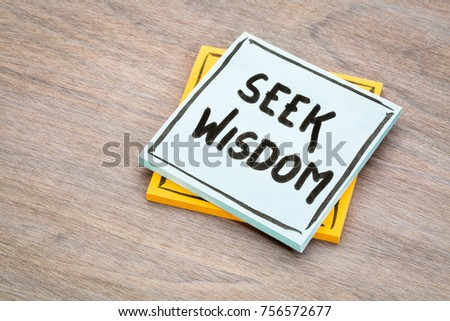seek wisdom advice or reminder handwriting on a sticky note against grained wood #756572677