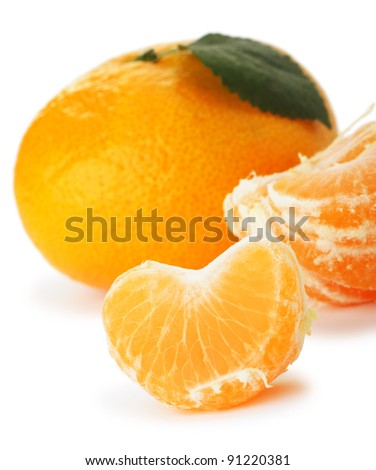 Segments and the whole tangerine. A detailed photo of fruit on a white background