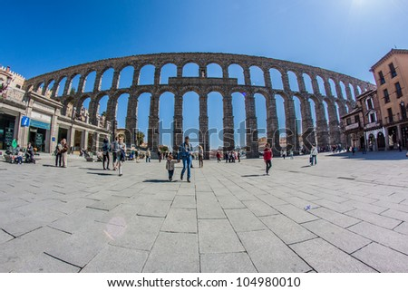 SEGOVIA - MAR 30: The Roman Aqueduct of Segovia on March 30, 2012 in Segovia, Spain. The famous monument has been chosen by Google to join the new World Wonders Project