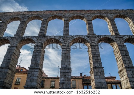 Segovia, Spain. Ancient Roman aqueduct on Plaza del Azoguejo square and old building towns in Segovia, Spain. Segovia, Castilla and Leon, Spain, Roman aqueduct, emblematic monument of the city and Wor stock photo