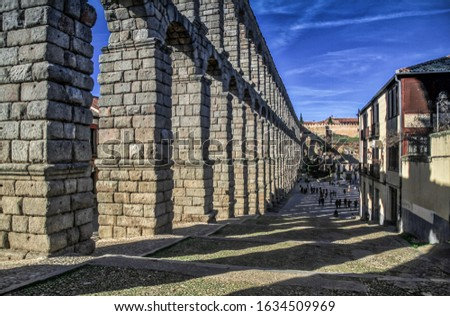 Segovia, Spain. Ancient Roman aqueduct on Plaza del Azoguejo square and old building towns in Segovia, Spain. Segovia, Castilla and Leon, Spain, Roman aqueduct, emblematic monument of the city  stock photo