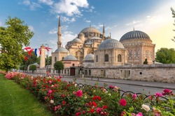 Sehzade Mosque or the Prince Mosque on sunset with flowers in Istanbul