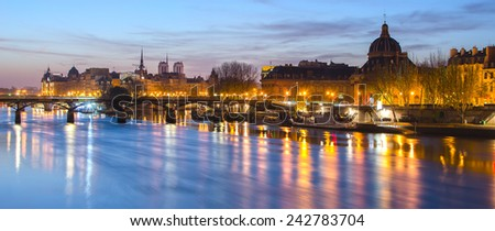 Seine river and Old Town of Paris (France) in the beautiful sunrise. A nice skyline of famous touristic destination with Notre Dame de Paris. Spectacular representative picture of French capital city.