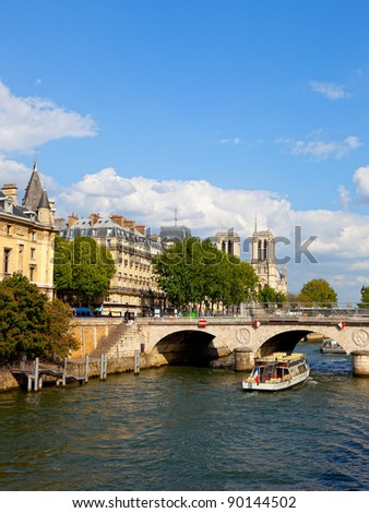 Seine river with tourists ships and cathedral Notre Dame in the background. Paris, France.