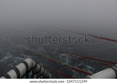 Seismic survey lead-ins disappearing into the mist