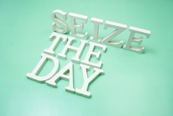 Seize The Day alphabet letters on green background