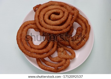 Sel roti is a Nepali traditional homemade, sweet, ring-shaped rice bread doughnut Stock fotó ©