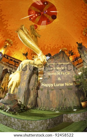 SELANGOR, MALAYSIA - JANUARY 8: Chinese New Year decorations at Sunway Pyramid Shopping mall on January 8, 2012 in Selangor, Malaysia. In Chinese Horoscopes 2012 is the year of the Dragon.