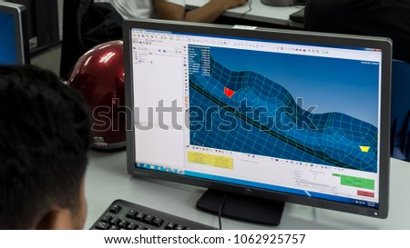 SELANGOR,MALAYSIA-MARCH 8,2018: A college students are designing and doing analysis in CAD software. Working on their project assignment in lab design near Bangi,Selangor. Shot taken on March 8,2018. #1062925757