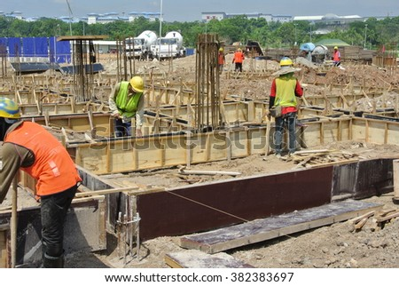 SELANGOR, MALAYSIA -MAY 12, 2014: Construction workers