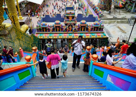 Selangor, Malaysia – 7 September 2018: The famous and iconic limestones with new rainbow painting at Batu Caves. The cave is the focal point of Hindu festival of Thaipusam in Malaysia. #1173674326