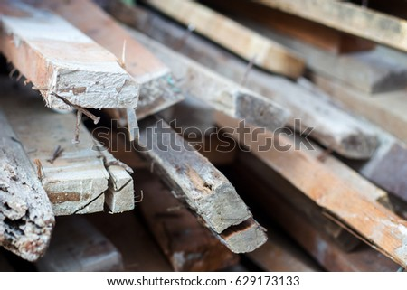select focus on wood log and rusty nail  #629173133