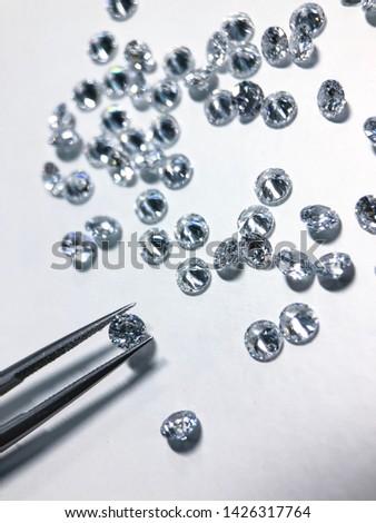 Select many diamond , cz , cubic zirconia , crystal.white background