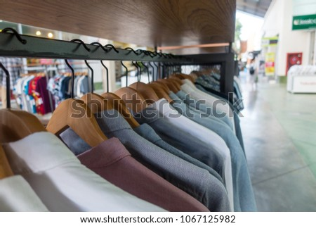 Select shirt shopping in super store #1067125982