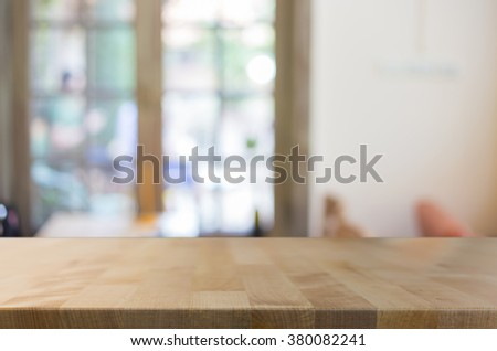 Selected focus empty brown wooden table and Coffee shop blur background with bokeh image, for product display montage. #380082241