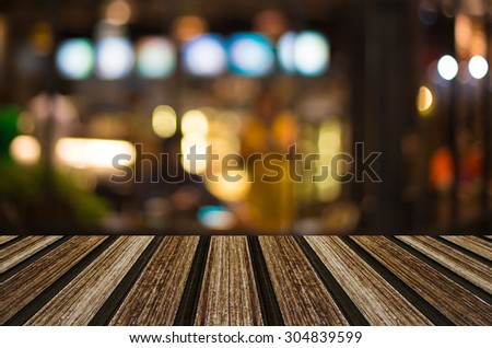 Selected focus empty brown wooden table and Coffee shop blur background with bokeh image for your photomontage or product display. #304839599