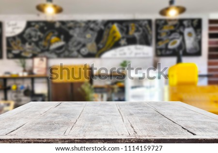 Selected focus empty brown wooden table and Coffee shop or restaurant blur background with bokeh image. for your photomontage or product display. #1114159727
