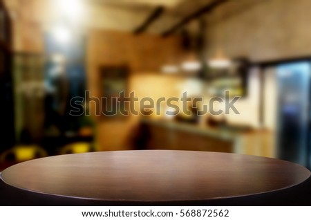 Selected focus empty brown wooden table and Coffee shop or restaurent blur background with bokeh image. for your photomontage or product display #568872562