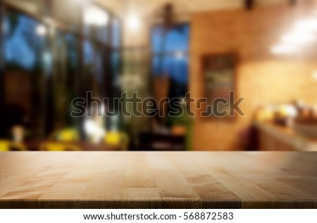 Selected focus empty brown wooden table and Coffee shop or restaurent blur background with bokeh image. for your photomontage or product display #568872583
