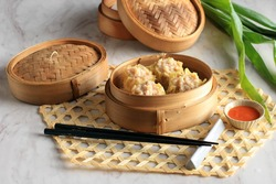 Selected Focus Shrimp Chinese/Korean Steamed Dumpling (Dim Sum or Shumai) with Sauce, on Bamboo Steamer