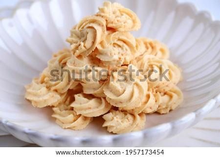 Selected Focus, SLoce Up Kukis Sagu Keju or Cheese Sago Cookies is one Favorite Cookies in Indonesia for Christmas or Lebaran. Сток-фото ©