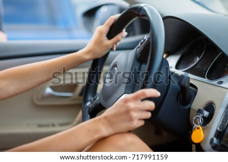 Selected focus Woman is hands on the steering wheel of the car #717991159