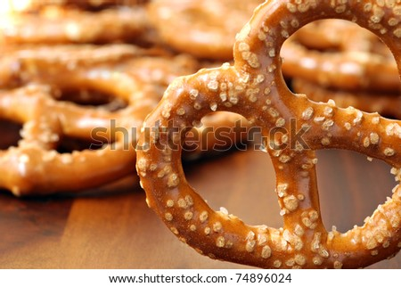 Selected pretzel up close with additional pretzels in soft focus in background.  Macro with extremely shallow dof.