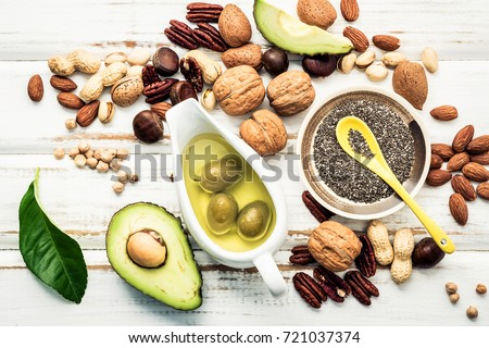Selection food sources of omega 3 and unsaturated fats. Superfood high vitamin e and dietary fiber for healthy food. Almond ,pecan,hazelnuts,walnuts and olive oil on stone background. Foto d'archivio ©