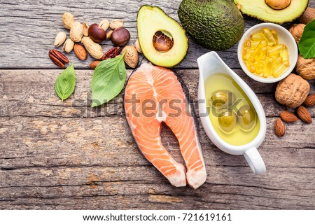Selection food sources of omega 3 and unsaturated fats. Superfood high vitamin e and dietary fiber for healthy food. Almond,pecan,hazelnuts,walnuts,olive oil,fish oil and salmon on wooden background. #721619161