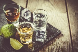 Selection of alcoholic drinks on rustic wood background